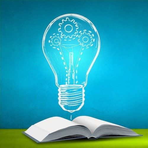 Colorful illustration with a blue background, an open book on a green surface and an illustrative lightbulb floating above the book with cogs attached to the filament of the lightbulb and a dotted line tracing the path.