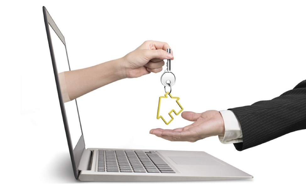 image of laptop cimputer with an arm reaching out and handing keys to a house to an extended open hand